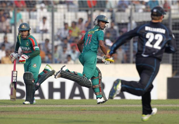 Bangladesh's captain Mushfiqur Rahim and teammate Naeem Islam run between the wickets as New Zealand's Kane Williamson runs to catch the ball in Dhaka