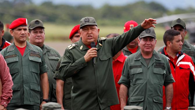 Venezuela's President Hugo Chavez, center, delivers a speech to soldiers in La Fria, Venezuela, Thursday, Oct. 20, 2011. Chavez said he is cancer-free because a series of medical exams in Cuba showed no recurrence of the illness following two months of chemotherapy treatments.  Chavez underwent surgery in Cuba in June to remove a cancerous tumor from his pelvic region. He has not revealed where the tumor was located nor the type of cancer with which he was diagnosed. (AP Photo/Fernando  Llano)