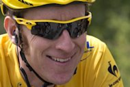 Britain's Bradley Wiggins, wearing the overall leader's yellow jersey, during stage 18 of the Tour de France on July 20. Wiggins could look to cap his imminently triumphant Tour de France campaign with victory in the penultimate stage time trial on Saturday
