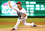 Texas Rangers' Yu Darvish pitches during the American League Wild Card playoff game against the Baltimore Orioles in October. The Rangers inked Darvish to a six-year, $60 million contract