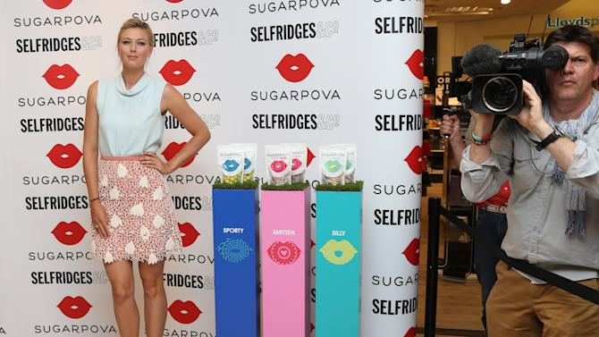 Russian tennis star Maria Sharapova poses for photos to launch Sugarpova, her new range of sweets at Selfridges store in central London, Thursday, June 20, 2013. (Photo by Joel Ryan/Invision/AP)