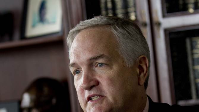 File- In the April 18, 2012 file photo, Alabama Attorney General Luther Strange talks with reporters in Montgomery, Ala. While Louisiana's attorney general spent $24 million building the state's legal case against BP. of that $15.4 million was paid to outside lawyers. Strange opted to let lawyers on his staff take on the work. So far the tab is well under $200,000. (AP Photo/Dave Martin, File)