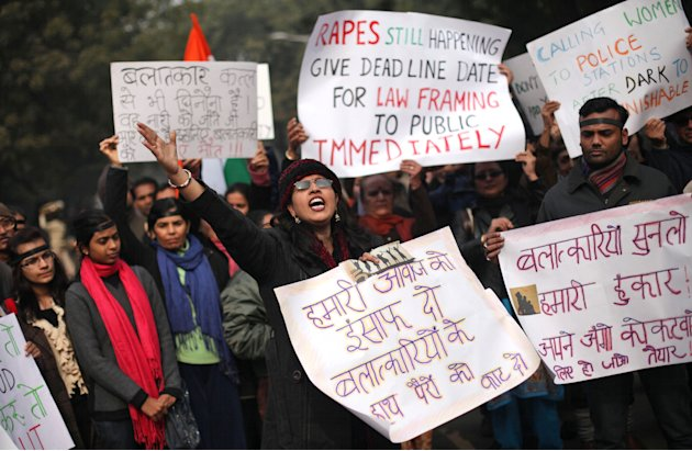 An Indian woman shouts slogans during a protest to mourn the death of a gang rape victim in New Delhi, India, Thursday, Jan. 3, 2013. Indian police were preparing Thursday to file rape and murder char