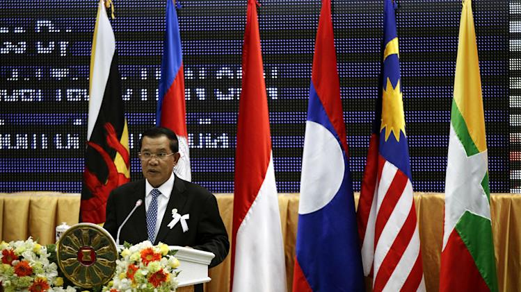 Cambodia's Prime Minister Hun Sen deliver his opening speaks for the 21st Association of Southeast Asian Nations or ASEAN Summit in Phnom Penh, Cambodia, Sunday, Nov. 18, 2012.  (AP Photo/Vincent Thian)