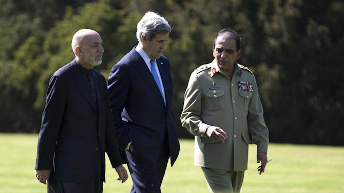 U.S. Secretary of State John Kerry, center, talks with Afghan President Hamid Karzai, left, and Pakistani Army Chief Gen. Asfhaq Parvez Kayani as they take a walk during a break in a meeting on Wednesday, April 24, 2013, in Brussels, Belgium. The trilateral meeting is to discuss regional security issues, and the 2014 withdrawal of NATO combat forces from Afghanistan. (AP Photo/Evan Vucci, Pool)
