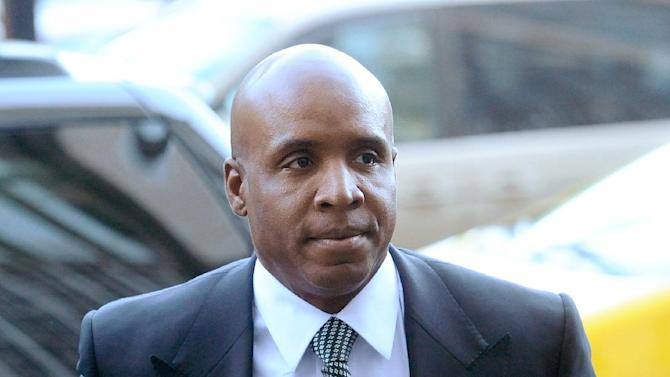 Former baseball player Barry Bonds arrives at federal court for sentencing on Friday, Dec. 16, 2011, in San Francisco. Bonds, convicted in April of obstructing a government investigation into steroid use among athletes, faces up to 21 months in prison.   (AP Photo/Noah Berger)