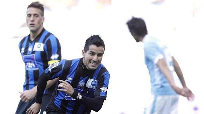 Atalanta midfielder Maximiliano Moralez, of Argentina, celebrates after scoring during a Serie A soccer match between Lazio and Atalanta, at Rome's Olympic stadium, Sunday, March 9, 2014