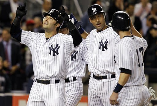Suzuki, Swisher send first-place Yanks over Jays