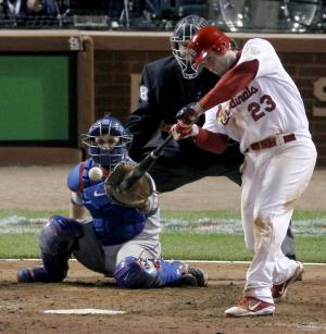 St. Louis Cardinals' David Freese hits a solo home run off a pitch by Texas Rangers' Mark Lowe in the 11th inning of Game 6 of baseball's World Series Thursday, Oct. 27, 2011, in St. Louis. The Cardinals won 10-9. (AP Photo/Jeff Roberson)