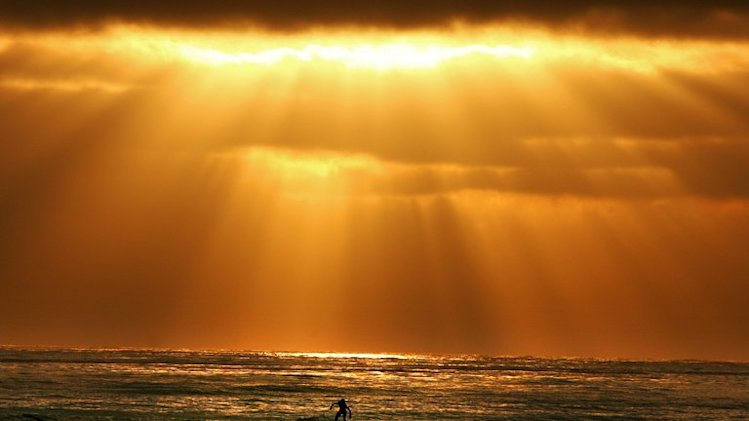 A surfer enjoys the waves on June 23, 2005 at Cardiff State Beach in Cardiff-By-The-Sea, California
