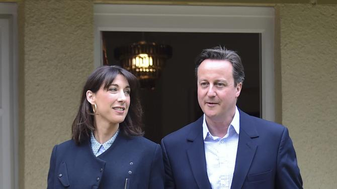 Britain's Prime Minister Cameron is joined by his wife Samantha during a campaign visit to a home building scheme in Lancaster, northern England