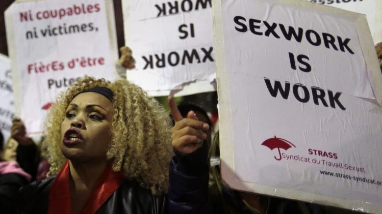 Sex workers attend a protest demonstration after French deputies voted for a reform of prostitution law in Paris