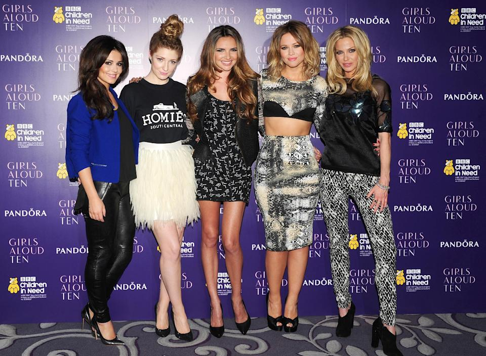 From left, Cheryl Cole, Nicola Roberts, Nadine Coyle, Kimberley Walsh and Sarah Harding of girl band Girls Aloud at a press conference at an hotel in London to announce Friday Oct. 19, 2012, that they will reunite for a tour next year. (AP Photo/PA, Ian West) UNITED KINGDOM OUT  NO SALES  NO ARCHIVE