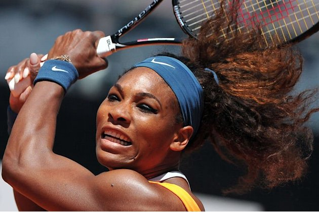 Serena Williams returns the ball to Romania's Simona Halep during their semi-final on May 18, 2013 at the Rome Masters