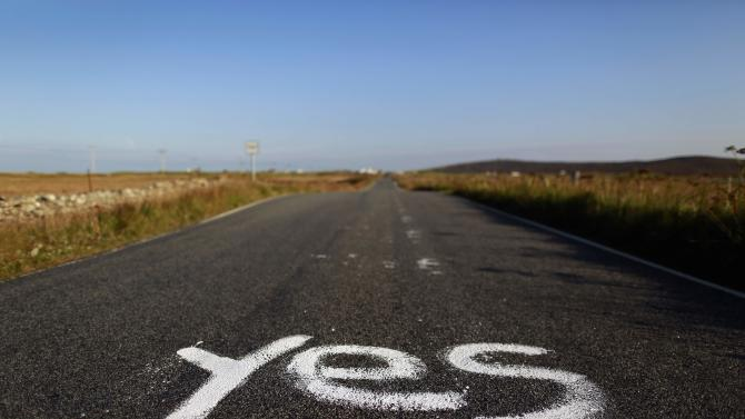"""Graffiti supporting the """"Yes"""" campaign is painted on a road in North Uist in the Outer Hebrides"""
