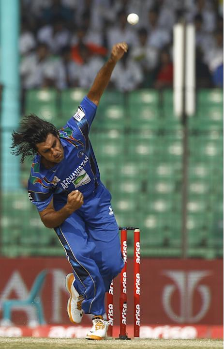 Afghanistan's Shapoor Zadran bowls during their match against Pakistan in the Asia Cup one-day international cricket tournament in Fatullah, near Dhaka, Bangladesh, Thursday, Feb. 27, 2014. (AP Photo/