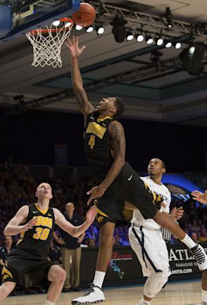 No. 23 Iowa rallies past Xavier, 77-74 in OT