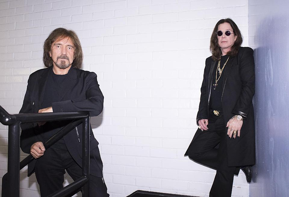 This June 6, 2013 photo shows singer Ozzy Osbourne, right, and musician Geezer Butler of the rock band Black Sabbath posing for a portrait  in Los Angeles. (Photo by Dan Steinberg/Invision/AP)
