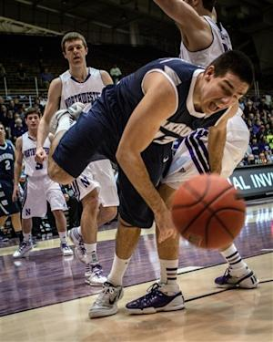 Northwestern holds off Akron 76-74 in NIT