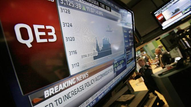 The rate decision of the Federal Reserve is announced on a television screen on the floor of the New York Stock Exchange Thursday, Sept. 13, 2012.  The Federal Reserve unleashed a series of aggressive actions Thursday intended to stimulate the still-weak economy by making it cheaper for consumers and businesses to borrow and spend. (AP Photo/Richard Drew)