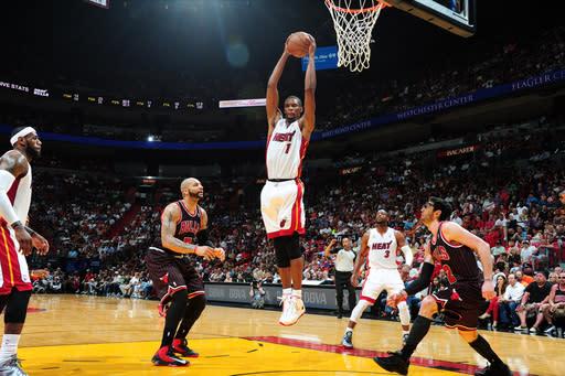 Heat set franchise home mark, top Bulls 105-93