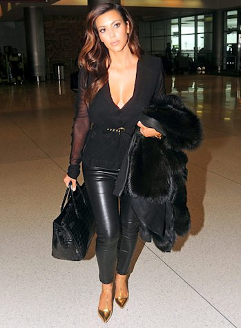 Kim Kardashian Wears Tight Leather Pants, Fur in 90-Degree Miami Heat