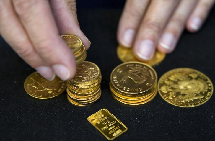 Gold climbs as dollar retreats ahead of Fed meeting