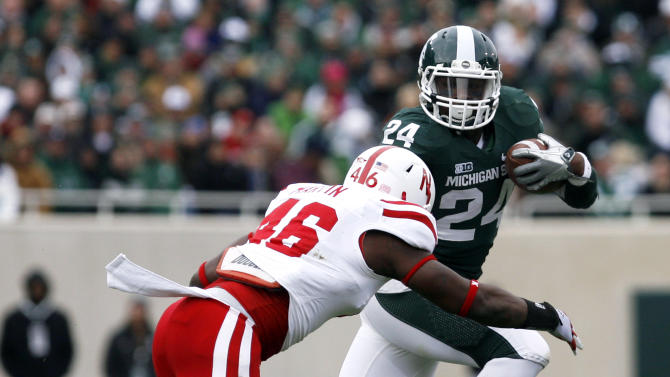 Michigan State's Le'Veon Bell (24) rushes against Nebraska's Eric Martin during the first quarter of an NCAA college football game, Saturday, Nov. 3, 2012, in East Lansing, Mich. (AP Photo/Al Goldis)