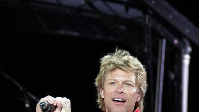 "FILE - This July 27, 2011 file photo shows singer Jon Bon Jovi performing during Bon Jovi's ""Open Air Tour"" show at Estadio Olympico, in Barcelona, Spain. Avon Products Inc. announced Monday, July 2, 2012, that the 50-year-old rock star is the company's newest celebrity fragrance partner. He'll appear in ads for both Unplugged for Her and Unplugged for him.  The company said the inspiration for both scents is the unique feeling one has listening to a favorite song. The goal is ""an emotional connection."" The women's version, which will be available through Avon representatives and online in October, is a floral oriental perfume, and the men's is a woody floral musk fragrance. It will go on sale in November. (AP Photo/Job Vermeulen, file)"