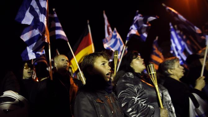 Supporters of the far-right Golden Dawn party wave Greek national and party flags  during a rally in Athens