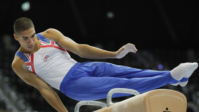Louis Smith of Britain performs on the pommel horse during the men's qualifying session for the World Gymnastics Championships in Rotterdam, Netherlands, Monday Oct. 18, 2010. (AP Photo/Bas Czerwinski)