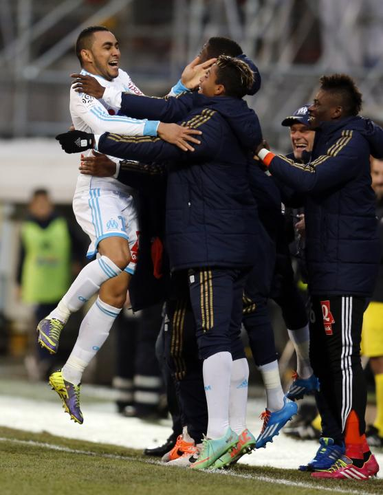 Olympique Marseille's Payet celebrates with team mates after scoring against Bastia during their French Ligue 1 soccer match at the Velodrome stadium in Marseille