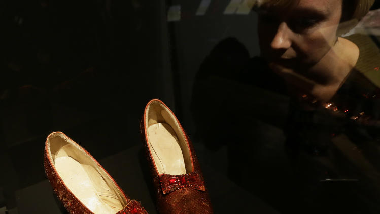 One of the four original pairs of 'Ruby Slippers' worn by Judy Garland playing Dorothy from the iconic 1939 Wizard of Oz film on view at the Hollywood Costume exhibition at the Victoria and Albert Museum in London, Tuesday, Oct. 16, 2012. The slippers are on loan from the Smithsonian National Museum of American History and are on display till Nov. 18, when they must return to the US, so that they are back in time for the Thanksgiving national holiday. The slippers were designed by MGM studios chief costume designer Adrian, who designed most of the costumes for the Wizard of Oz film.  The show at the Victoria and Albert Museum showcases more than one hundred movie costumes from a century of film-making. The exhibition opens to the public on Oct. 20, 2012 and run till 27 Jan. 2013.(AP Photo/Alastair Grant)