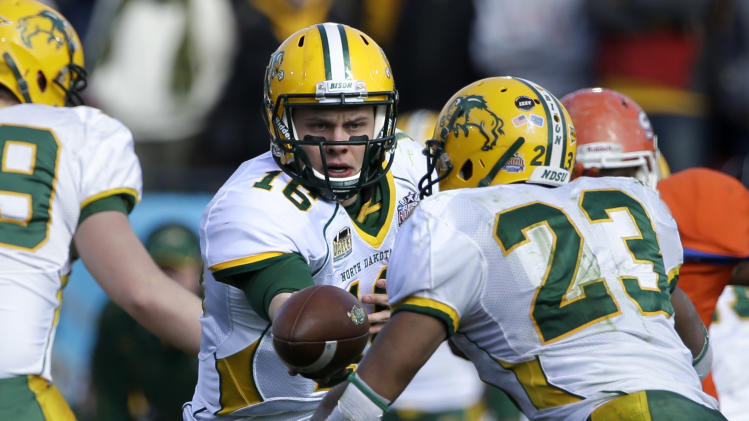 North Dakota State's Brock Jensen (16) hands off to running back John Crockett (23) during the first half of the FCS Championship NCAA college football game against Sam Houston State, Saturday, Jan. 5, 2013, in Frisco, Texas. (AP Photo/Tony Gutierrez)