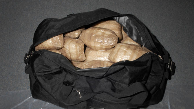This Wednesday,  Nov. 21, 2012 photo supplied by the Australian Federal Police shows small portion of a US$246 million drug haul seized in Sydney. The Australian Federal Police said Wednesday that they arrested a Canadian man and a U.S. man after officers had seized 350kg (770 pound) of cocaine and methamphetamine hidden inside a steamroller shipped from China. (AP Photo/Australia Federal Police)