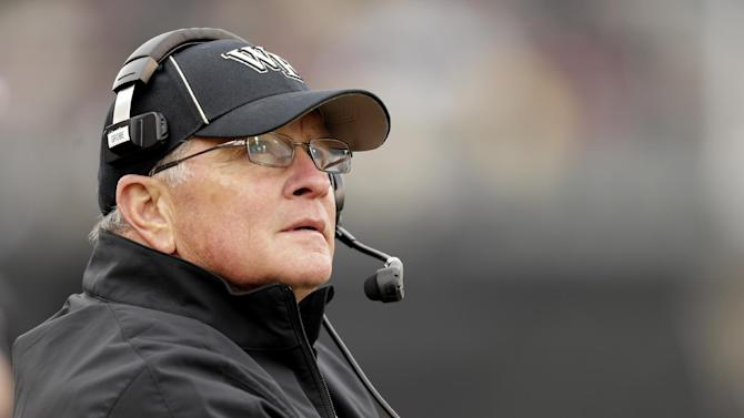 Wake Forest head coach Jim Grobe looks at the scoreboard as his team plays Florida State in the second half of an NCAA college football game in Winston-Salem, N.C., Saturday, Nov. 9, 2013. Florida State won 59-3