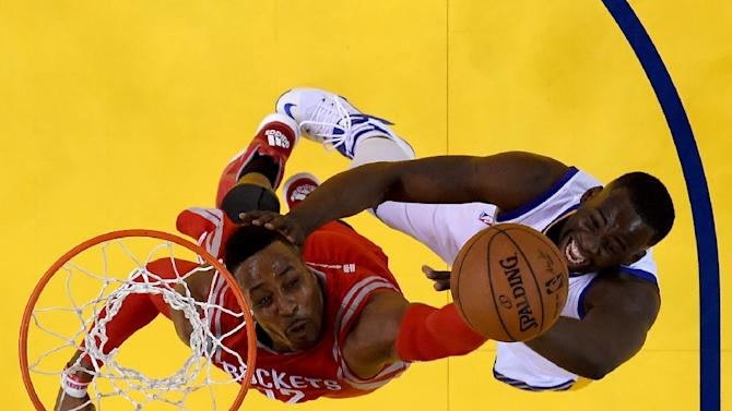 Dwight Howard (L) of the Houston Rockets and Draymond Green of the Golden State Warriors go after the ball during game five of the Western Conference Finals of the 2015 NBA Playoffs at ORACLE Arena on May 27, 2015 in Oakland, California