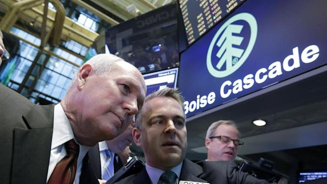 Boise Cascade Chief Executive Officer Thomas Carlile, left, confers with specialist Christopher Culhane during his company's IPO, on the floor of the New York Stock Exchange Wednesday, Feb. 6, 2013. Strong earnings reports from media giants Disney and Time Warner aren't impressing investors in early trading, and major U.S. market indexes are opening lower. (AP Photo/Richard Drew)