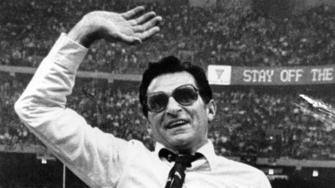 FILE - In this Jan. 1, 1983 file photo, Penn State head football coach Joe Paterno waves as he gets a victory ride in the Louisiana Superdome after winning the national championship with a 27-23 win over Georgia in the Sugar Bowl in New Orleans. Paterno say he plans to retire at the end of the season, his long and illustrious career brought down because he failed to do all he could about an allegation of child sex abuse against a former assistant.  (AP Photo/Bill Feig, File)