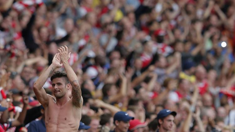 Arsenal's Giroud reacts after their English Premier League soccer match against Tottenham Hotspur at the Emirates