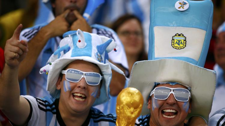Argentina fans wait for the 2014 World Cup Group F soccer match between Argentina and Bosnia at the Maracana