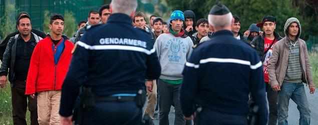 England, France vow united front over migrants