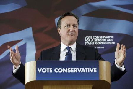 Britain's Prime Minister David Cameron delivers a speech during an election visit to Nuneaton