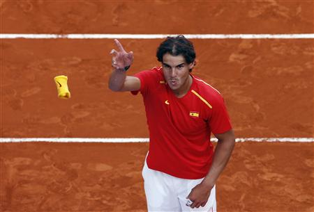 Spain's Nadal throws his wristband to the public after winning against Ukraine at the end of their Davis Cup World Group playoff tennis tie in Madrid