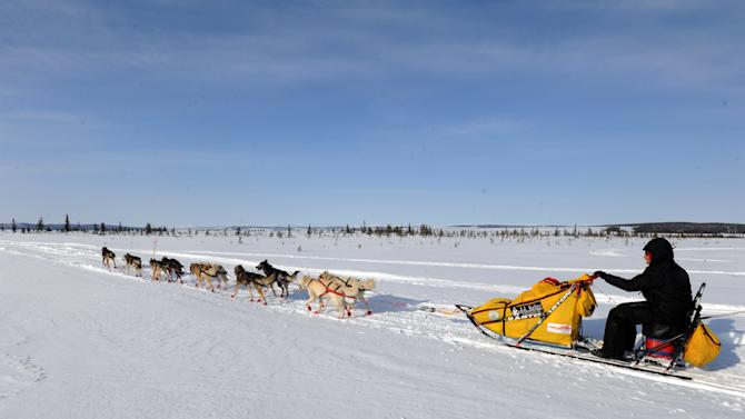 Mitch Seavey drives his dog team towards Nome, Alaska, after leaving the White Mountain checkpoint, Tuesday, March 12, 2013, during the Iditarod Trail Sled Dog Race. (AP Photo/The Anchorage Daily News, Bill Roth)  LOCAL TV OUT (KTUU-TV, KTVA-TV) LOCAL PRINT OUT (THE ANCHORAGE PRESS, THE ALASKA DISPATCH)