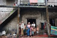 Muslim Rohingyas shelter at an Islamic school for Internally Displaced Persons (IDP) on the outskirts of Sittwe on October 10. Surging sectarian violence in western Myanmar has left at least 64 people dead and scores more wounded, a local official says, casting a shadow over the government&#39;s reform drive