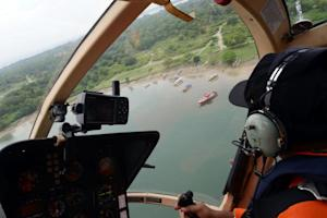 A rescue team search for seven Japanese tourists who…