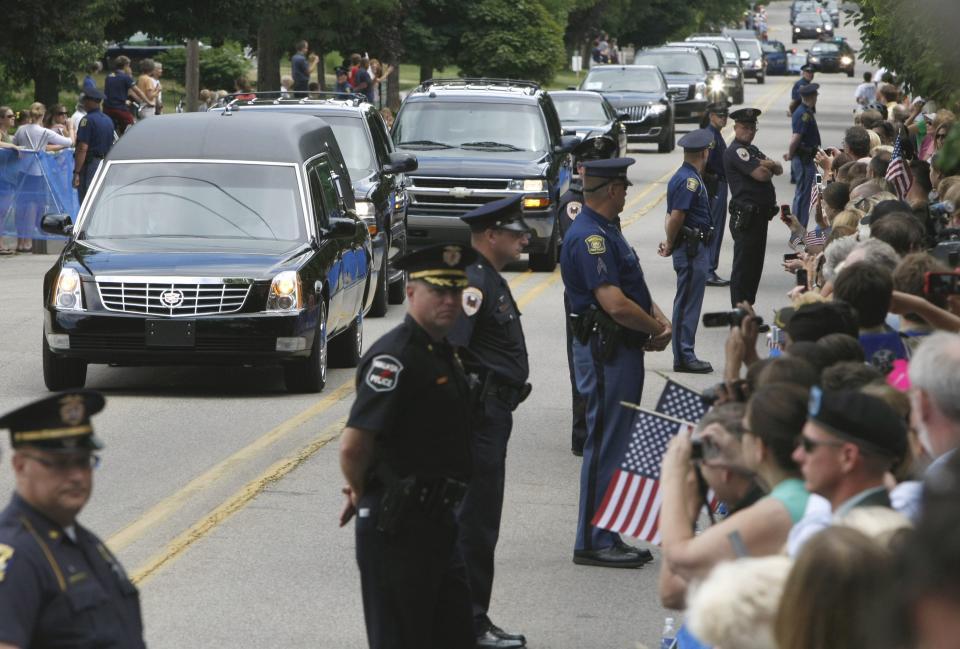 A hearse carrying the casket of former first lady Betty Ford arrives at at Grace Episcopal Church in Grand Rapids, Mich., Thursday, July 14, 2011, for funeral services. (AP Photo/Kiichiro Sato)