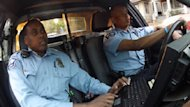 Officers Mohamed Abdullahi and Abdiwahab Ali patrol the Cedar-Riverside neighbourhood in their cruiser.