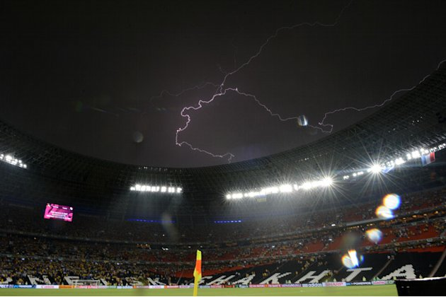 TOPSHOTS A Lighting Is Pictured As The Euro 2012 Championships Football Match Ukraine Vs France Is Suspended Due To AFP/Getty Images